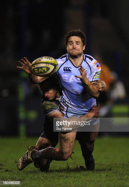 Blues player Alex Walker gets the ball away despite the attentions of Pat Phibbs during the LV= Cup match between Cardiff Blues and London Irish at...