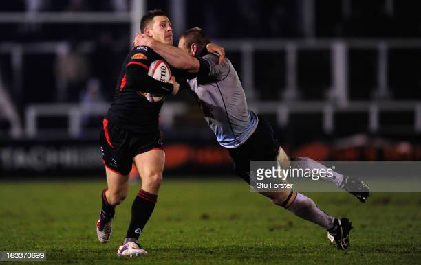 Blues player Darren Fox tackles Jimmy Gopperth of the Falcons during the RFU Championship match between Newcastle Falcons and Bedford Blues at...