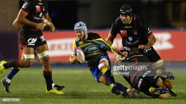 Blues player Matthew Morgan is tackled by Richard Choirat of Lyon during the European Rugby Challenge Cup match between Cardiff Blues and Lyon at...