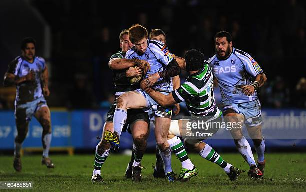 Blues player Rhys Patchell is wrapped up by Mike Mayhew and Bryn Evans of London Irish during the LV= Cup match between Cardiff Blues and London...