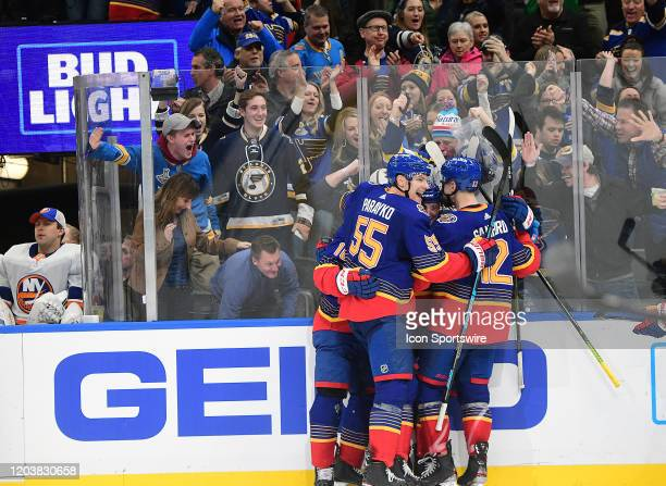 Blues players celebrate after a goal by St Louis Blues defenseman Vince Dunn ties the game during an NHL game between the New York Islanders and the...