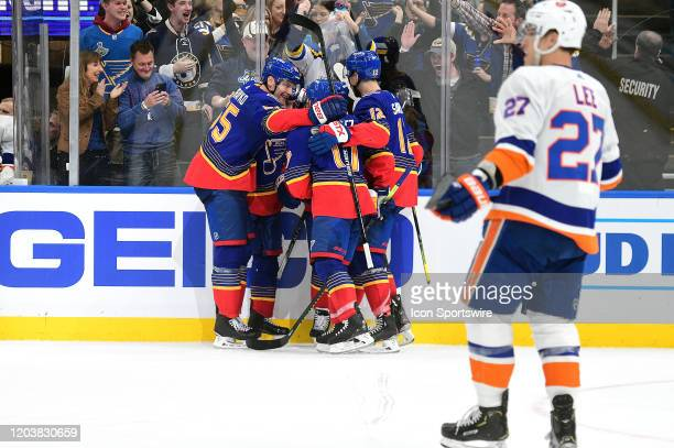 Blues players celebrate after a tying goal by St Louis Blues defenseman Vince Dunn during an NHL game between the New York Islanders and the St Louis...