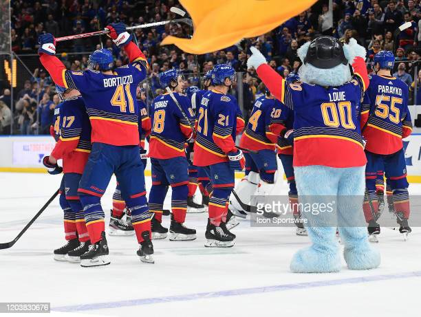 Blues players celebrate after a winning goal by St Louis Blues defenseman Colton Parayko during an NHL game between the New York Islanders and the St...