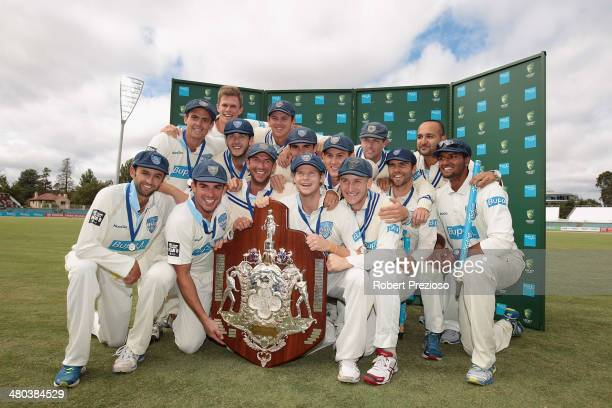 Blues players celebrate after winning the final during day five of the Sheffield Shield match between New South Wales Blues and the Western Australia...