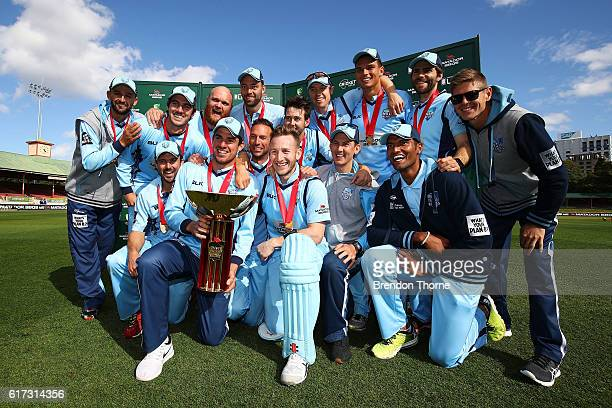 Blues players celebrates with the Matador BBQs One Day Cup after victory in the Matador BBQs One Day Cup Final match between Queensland and New South...