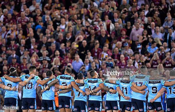 Blues players embrace before game two of the State Of Origin series between the Queensland Maroons and the New South Wales Blues at Suncorp Stadium...