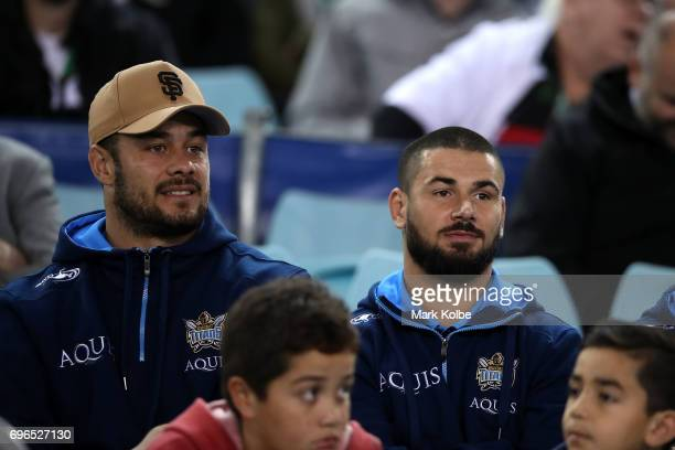 Blues players Jarryd Hayne and Nathan Peats of the Titans watch on from the grandstand during the round 15 NRL match between the South Sydney...