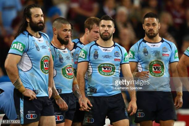 Blues players look dejected after a Maroons try during game three of the State Of Origin series between the Queensland Maroons and the New South...