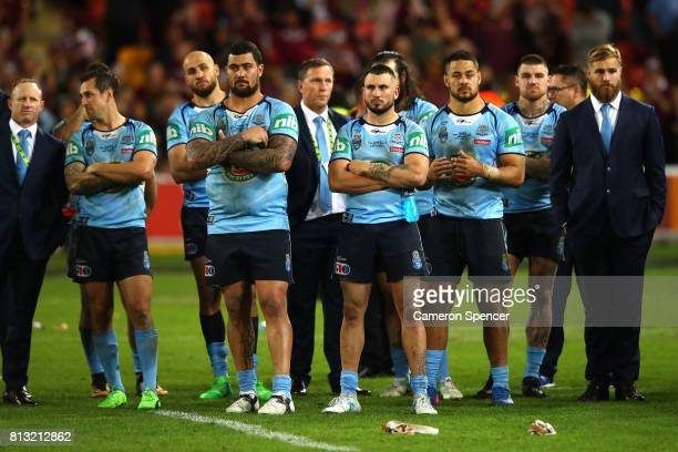 Blues players look dejected after game three of the State Of Origin series between the Queensland Maroons and the New South Wales Blues at Suncorp...