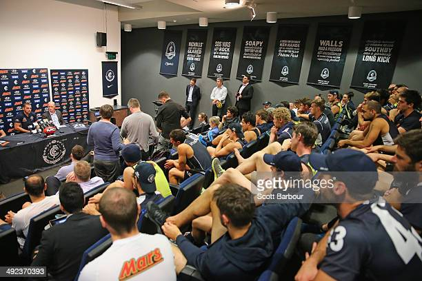 Blues players look on as Heath Scotland speaks to the media as he announces his retirement during a Carlton Blues AFL press conference at Visy Park...