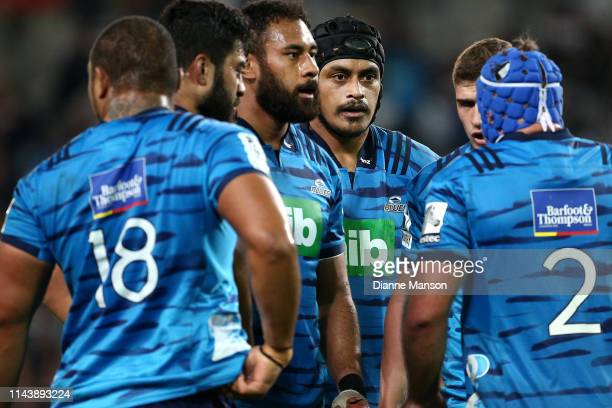 Blues players look on during the round 10 Super Rugby match between the Highlanders and the Blues at Forsyth Barr Stadium on April 20 2019 in Dunedin...