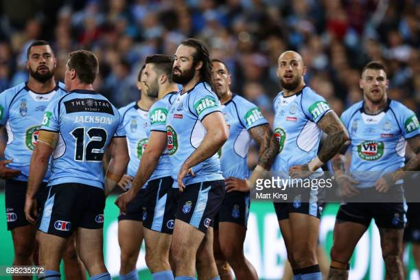 Blues players looks dejected after the first Maroons try during game two of the State Of Origin series between the New South Wales Blues and the...