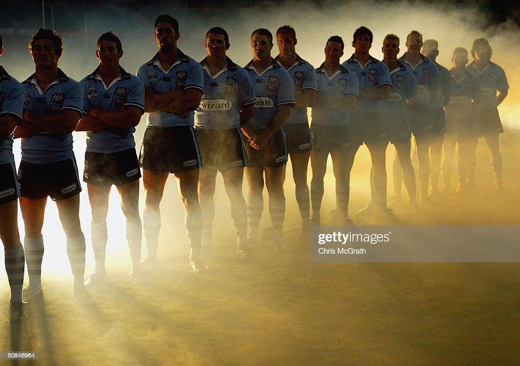 Blues players pose amidst smoke for a television commercial during the NSW Blues, State Of Origin training held at the Sydney Cricket Ground, May 17, 2004 in Sydney, Australia.