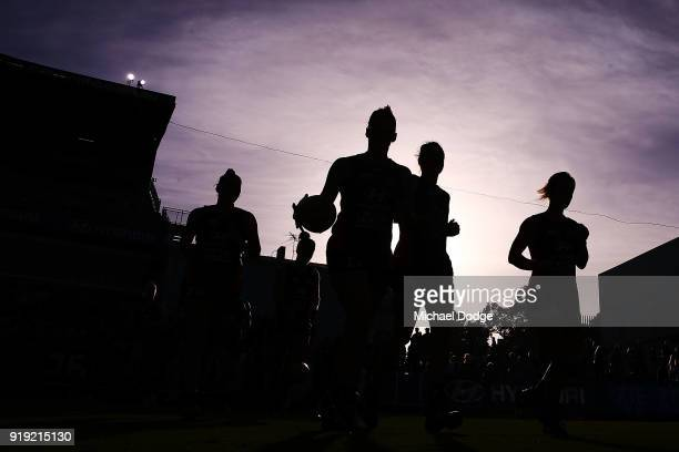 Blues players run out for warm up during the round three AFLW match between the Carlton Blues and the Brisbane Lions at Ikon Park on February 17 2018...