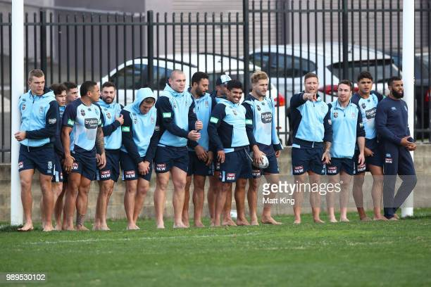 Blues players take part in a drill in bare feet during a New South Wales Blues State of Origin Recovery Session at Coogee Oval on July 2 2018 in...
