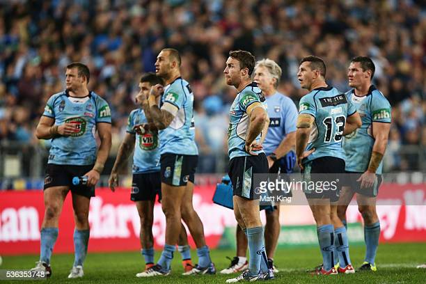 Blues players wait for the bunker decision on the Josh Morris attempeted try during game one of the State Of Origin series between the New South...