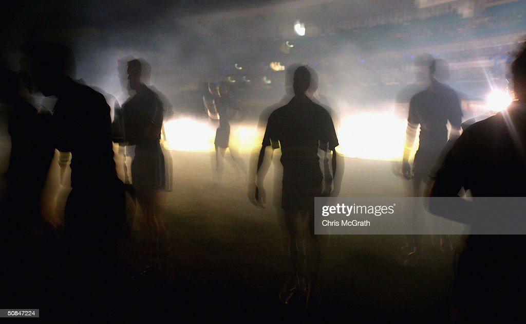 Blues players walk through smoke created for a Television commercial during the NSW Blues, State Of Origin training held at the Sydney Cricket Ground, May 17, 2004 in Sydney, Australia.