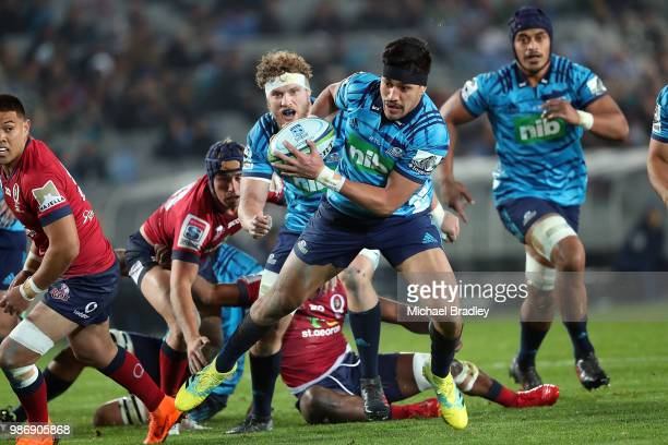 Blues Rieko Ioane runs the ball forward during the round 17 Super Rugby match between the Blues and the Reds at Eden Park on June 29 2018 in Auckland...