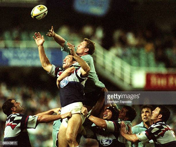 Blues Robin Brooke is held down in the lineout by the Waratahs Tom Bowman in the Super 12 match at the Sydney FootbalStadium Saturday The Blues won...
