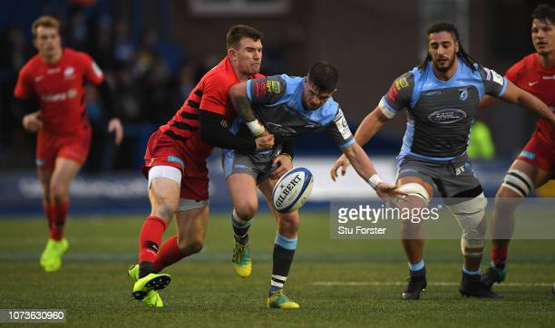Blues scrum half Lewis Jones is tackled by opposite number Ben Spencer during the Champions Cup match between Cardiff Blues and Saracens at Cardiff...