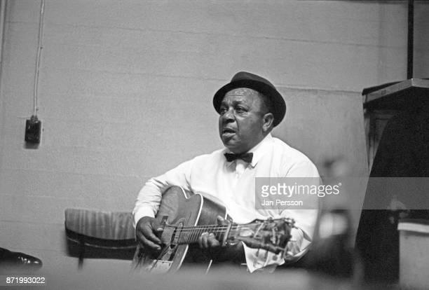 Blues singer and guitarist Big Joe Williams backstage at Tivoli Gardens Concert hall Copenhagen Denmark 1968