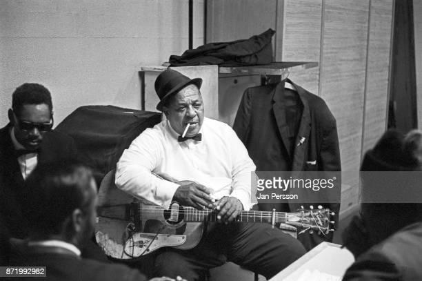 Blues singer and guitarist Big Joe Williams backstage with friends at Tivoli Gardens Concert hall Copenhagen Denmark 1968