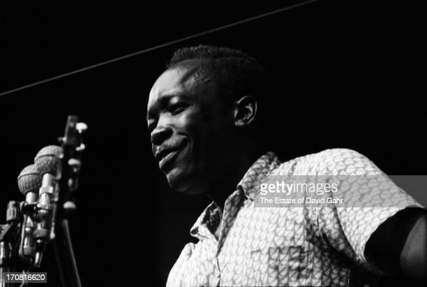 Blues singer and musician John Lee Hooker performs at the Newport Folk Festival in July 1963 in Newport Rhode Island