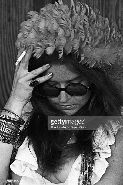 Blues singer and performer Janis Joplin waits backstage before a performance at the Newport Folk Festival in July 1968 in Newport Rhode Island