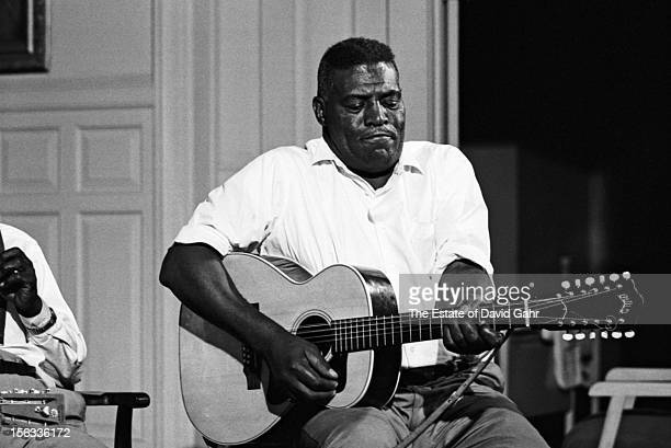 Blues singer, guitarist, and harmonica player Howlin' Wolf performs for a filmed blues and country music workshop at the Newport Folk Festival in...