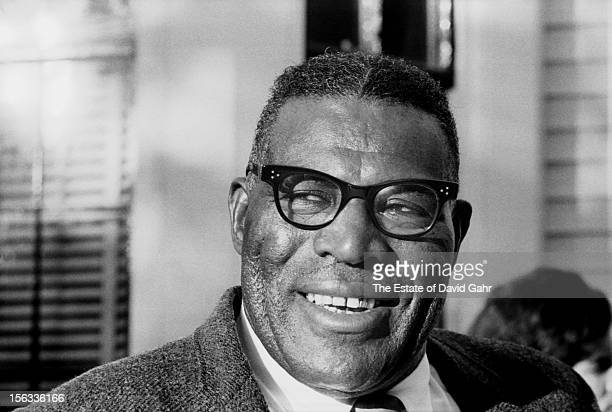 Blues singer, guitarist, and harmonica player Howlin' Wolf poses for a portrait backstage at the Newport Folk Festival in July, 1966 in Newport,...