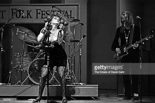 Blues singer Janis Joplin and guitarist Sam Andrew of the rock group Big Brother and the Holding Company perform at the Newport Folk Festival in July...