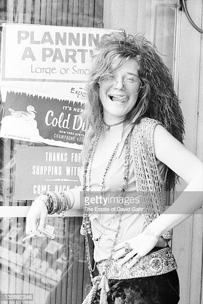 Blues singer Janis Joplin poses for a portrait on the street near the Chelsea Hotel in June 1970 in New York City New York
