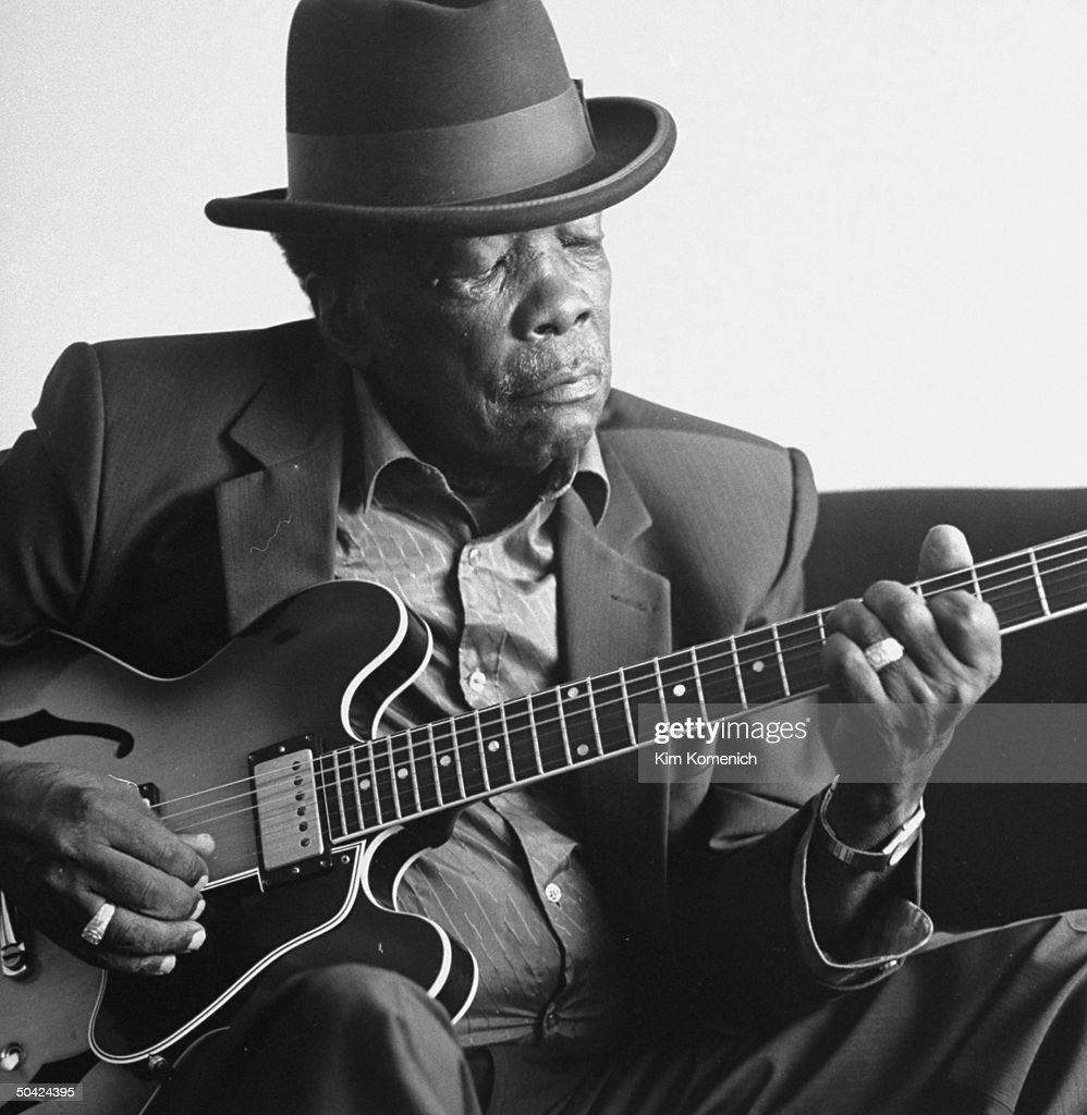 blues singer john lee hooker wearing hat playing his guitar at home news photo getty images. Black Bedroom Furniture Sets. Home Design Ideas