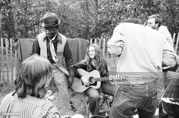Blues singer Mississippi Fred McDowell with singer Bonnie Raitt backstage at the Philadelphia Folk Festival at Old Pool Farm in July 1964 in Upper...
