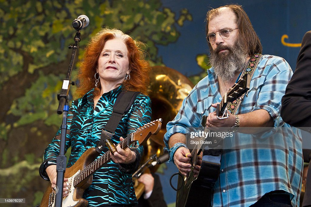 Blues singer-songwriter Bonnie Raitt and singer-songwriter Steve Earle perform on stage for the Preservation Hall and Friends 50th Anniversary Celebration during the 2012 New Orleans Jazz & Heritage Festival at the Fair Grounds Race Course on May 6, 2012 in New Orleans, Louisiana.