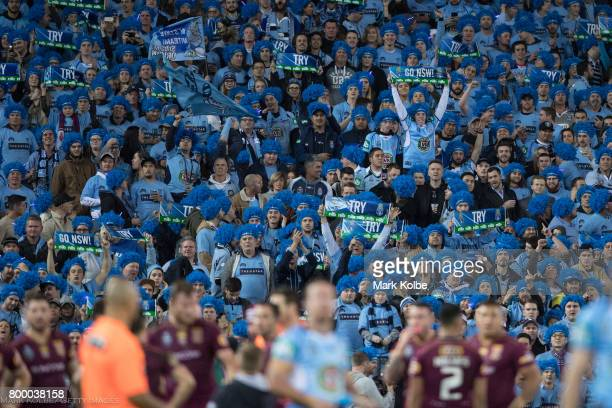 Blues supporters in the crowd cheer during game two of the State Of Origin series between the New South Wales Blues and the Queensland Maroons at ANZ...