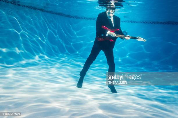 blues underwater guitarist - of jazz musicians stock pictures, royalty-free photos & images
