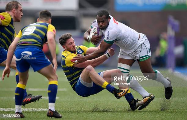 Blues wing Alex Cuthbert tackles Pau wing Watisoni Votu during the European Challenge Cup Semi-Final match between Cardiff Blues and Section Paloise...