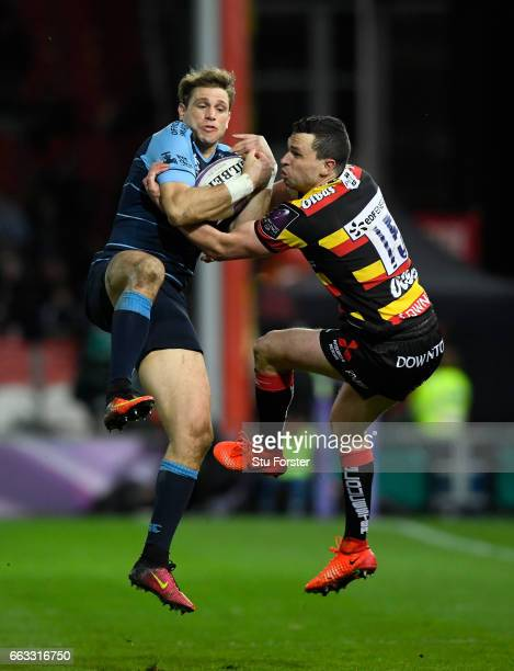 Blues wing Blaine Scully and Tom Marshall of Gloucester compete for a high ball during the European Rugby Challenge Cup match between Gloucester...