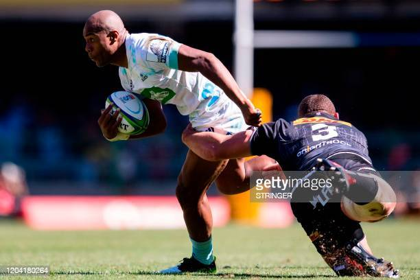 Blues wing Mark Telea runs with the ball as he is tackled by Stormers prop Wilco Louw on February 29 2020 during the Super Rugby match in Cape Town