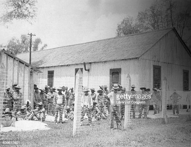 Bluesman Huddie Ledbetter known as Leadbelly standing in the foreground at prison compound No 1 in the Louisiana State Penitentiary