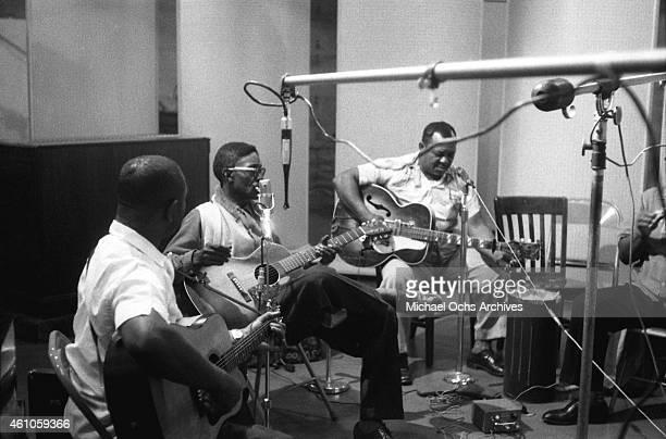 Bluesmen Brownie McGhee Lightnin' Hopkins Big Joe Williams and Sonny Terry in the studio recording Hopkins' album 'Penitentiary Blues' on July 1960...