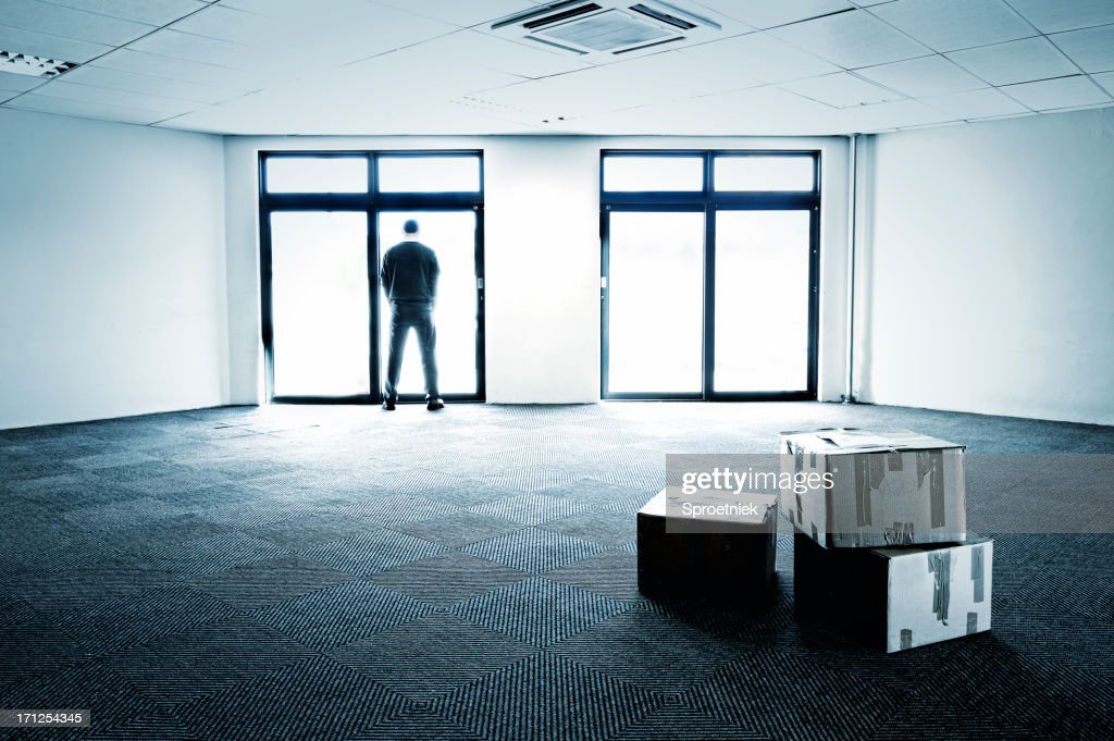 Blue-toned empty office showing business failure : Stock Photo