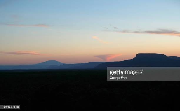 BLANDING UT MAY 11 Bluff and mountain ridgelines are silhouetted at sunset in the Bears Ears National Monument on May 11 2017 outside Blanding Utah...