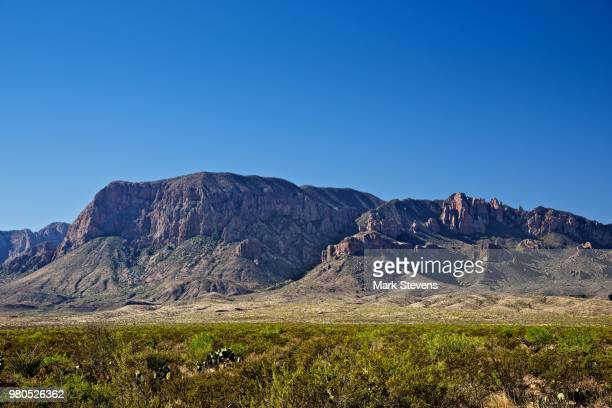bluffs, jagged peaks and hilltops of the chisos mountains - chisos mountains stock pictures, royalty-free photos & images