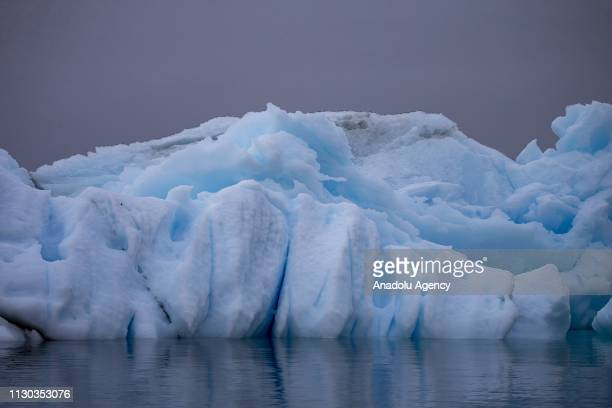 A bluish glacier is seen on ocean in Antarctica on February 26 2019 Turkish scientific research team has completed their navigation after set up a...