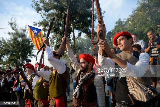 Blunderbuss guns are fired in Sant Julia de Ramis near Girona on October 1 2018 during a ceremony to commemorate the anniversary of a banned...