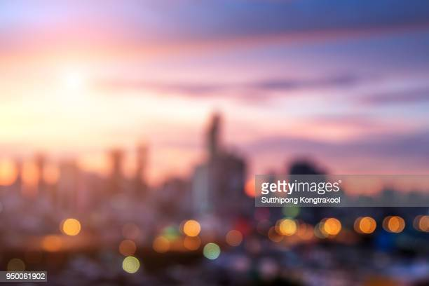blur background of landmark bangkok city. skyline view of modern building in business district with sunrise at bangkok city, thailand. hotel and resident district in the capital city of thailand - デフォーカス ストックフォトと画像