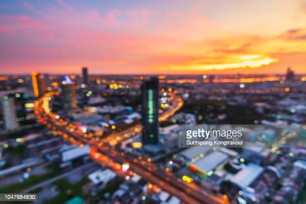 blur background of modern business city  with bokeh and sunset. light of building and business district with dramatic sky at bangkok , thailand - grounds stock pictures, royalty-free photos & images