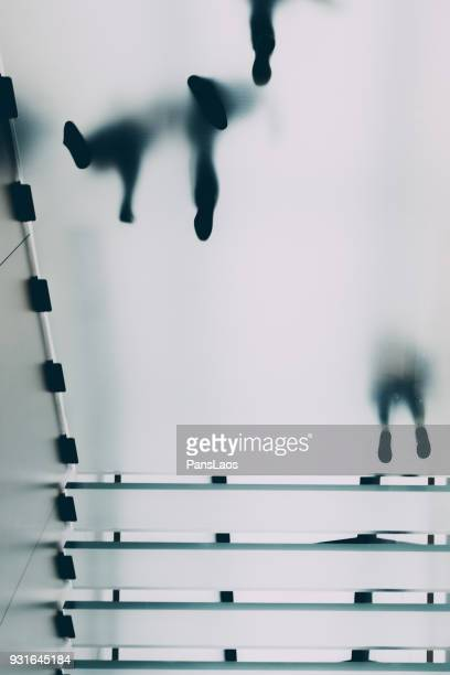 blur business people walking on glass staircase - man made structure stock pictures, royalty-free photos & images